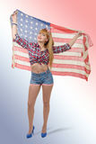 Sexy pin up girl  holding an American flag. A sexy pin up girl  holding an American flag Royalty Free Stock Images