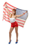 Sexy pin up girl  holding an American flag. A sexy pin up girl  holding an American flag on white background Royalty Free Stock Images