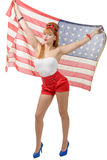 Sexy pin up girl isolated holding an American Flag. A sexy pin up girl isolated holding an American Flag Stock Photos