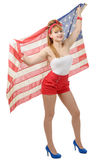 Sexy pin up girl isolated holding an American Flag. A sexy pin up girl isolated holding an American Flag Stock Image