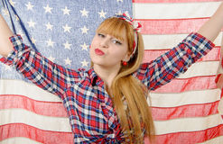 Sexy pin up girl isolated holding an American Flag Stock Photos