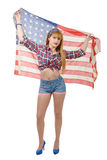 Sexy pin up girl isolated holding an American Flag. A sexy pin up girl isolated holding an American Flag Royalty Free Stock Photography