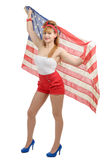 Sexy pin up girl isolated holding an American Flag. A sexy pin up girl isolated holding an American Flag Royalty Free Stock Images