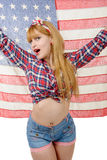 Sexy pin up girl isolated holding an American Flag. A sexy pin up girl isolated holding an American Flag Royalty Free Stock Photos