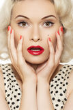 pin-up girl with retro make-up, red manicure Stock Images