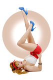Sexy pin-up girl in shorts and high heels lying on a floor Royalty Free Stock Photos