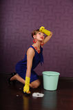 Sexy pin up housewife. Sexy housewife is cleaning the floor Royalty Free Stock Images