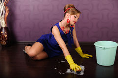 Sexy pin up housewife. Sexy housewife is cleaning the floor Stock Photo