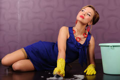 Sexy pin up housewife. Sexy housewife is cleaning the floor Stock Photography