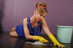 Sexy pin up housewife. Sexy housewife is cleaning the floor Stock Images