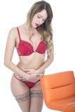 Sexy Pin Up Model in de Maag van de Lingerieholding Stock Foto's