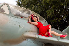 Sexy pin-up model on vintage airplane Stock Image