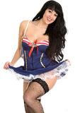 Sexy Pin Up Model Wearing Short Sailors Dress with Fish Net Stockings Stock Photography