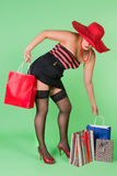 Sexy pin up shopping. Sexy pin up girl holding paper shopping bags Royalty Free Stock Image