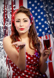 Sexy pin-up woman with champagne Royalty Free Stock Image