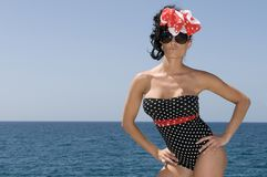 Pin up woman near the sea with blue day backg. Round and copy space royalty free stock photography