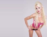 Sexy pink girl over white Stock Photos