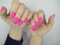 Sexy pink manicure. On long beautiful nails woman makeup beauty lips girl fashion face model color african lipstick background glamour salon polish black hand royalty free stock images
