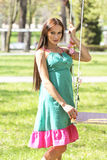 Sexy pink purple green dress lady on a swing Stock Images