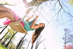 Sexy pink purple green dress lady on a swing Royalty Free Stock Photography