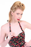 Sexy Pinup Girl. Pretty Blond Pinup Girl in a Rockabilly Cherry Stem Print Dress Stock Photos