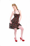 Sexy Pinup Girl. Pretty Blond Pinup Girl Standing on a High Key Background in a Retro Dress Stock Image