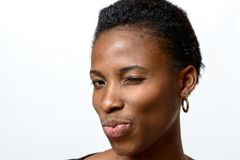 Sexy playful African woman winking at camera Stock Photography