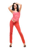 Sexy playful young brunette in a red jeans Royalty Free Stock Images