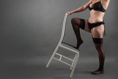 Sexy plump young bbw girl in black lingerie and stockings Stock Images