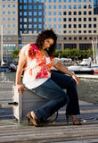 Plus size woman sitting. Beautiful plus size woman sitting at a marina dock stock photography