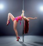 Sexy pole dance woman. Royalty Free Stock Photos