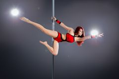 Sexy pole dance woman. Young sexy pole dance woman Royalty Free Stock Photo