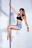 Sexy pole dance woman Royalty Free Stock Image