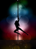 Sexy pole dancer. Silhouette of a sexy female pole dancing on a colourful lights background Stock Photos