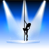 Sexy pole dancer. Silhouette of a sexy pole dancer on a podium with spotlights Stock Photos