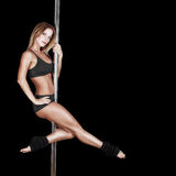 Sexy pole dancer on black Stock Image