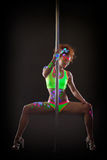 Sexy pole dancer posing with luminous UV makeup Royalty Free Stock Photos