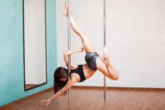 Sexy pole dancer showing off Stock Image