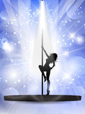 Sexy pole dancer. Silhouette of a sexy pole dancer on a podium Royalty Free Stock Photography
