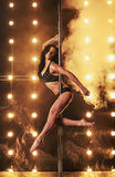 Sexy pole dancer Royalty Free Stock Image