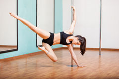 Sexy pole dancer working out Stock Photo
