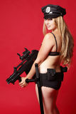 Sexy police officer with gun Royalty Free Stock Image