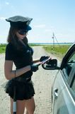 Sexy police woman on road Royalty Free Stock Photo