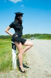 Sexy police woman on road Royalty Free Stock Photos