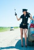 Sexy police woman on road Stock Image