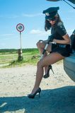 Sexy police woman on road Stock Photo