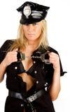 Sexy politieagente wih handcuffs stock foto