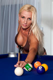 Pool player. 30 something caucasian woman playing pool in bikini stock photos