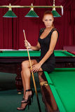Sexy pool player. Royalty Free Stock Image
