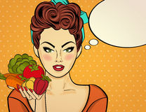 Sexy pop art woman with vegetables in his hand Stock Photography